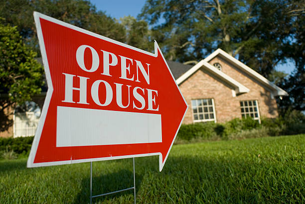 red open house sign pointing at house for inspection - house stock pictures, royalty-free photos & images