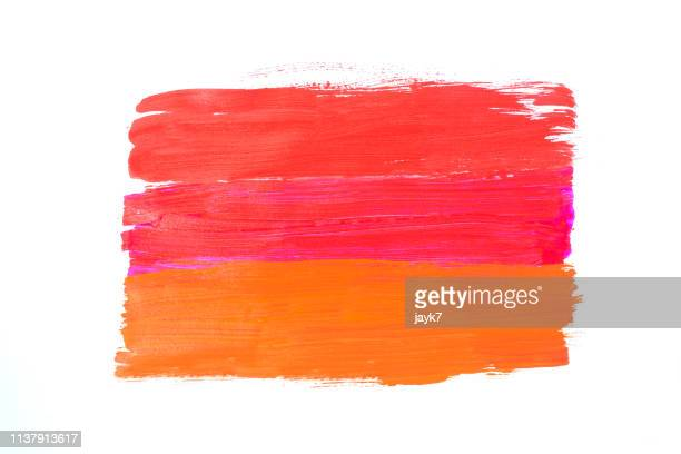 red orange and pink paint stroke - stroking stock pictures, royalty-free photos & images
