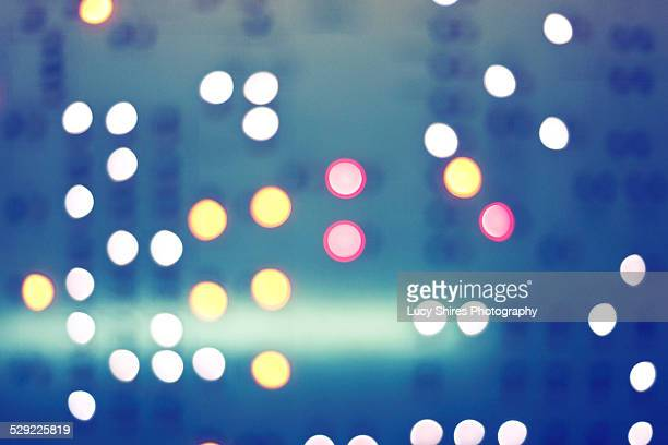 red, orange and white lights with green background - lucy shires stock pictures, royalty-free photos & images