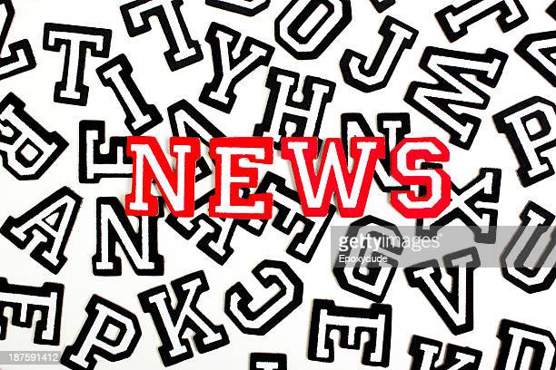 Red outlined varsity font stickers spelling News on top of black outlined letters