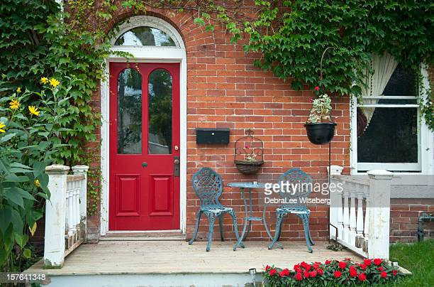 Red outside door with a patio and seating