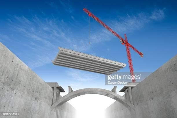 Red overhead crane building bridges