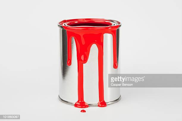 Red Paint Dripping Down A Paint Can