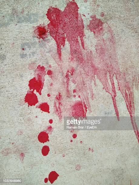 red paint on wall - blood splatter stock photos and pictures