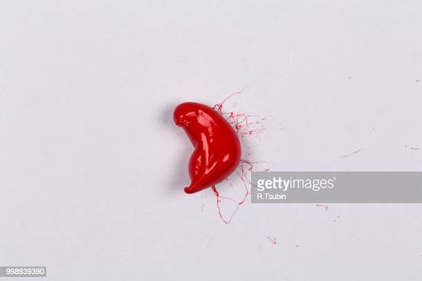 Red paint splash on a white paper