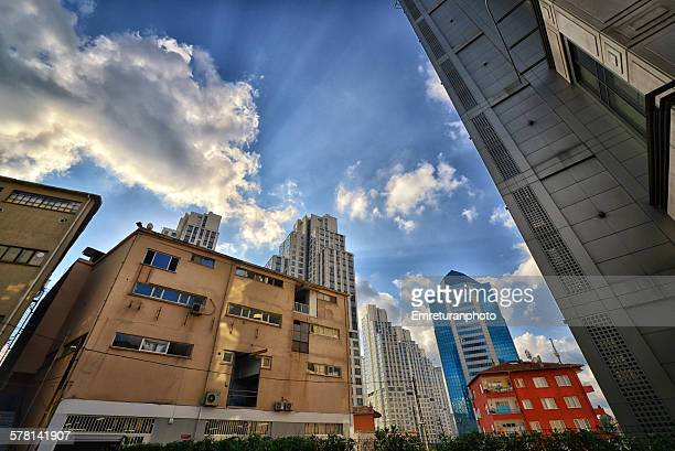 red painted building between high rises - emreturanphoto stock pictures, royalty-free photos & images