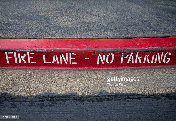 red painted curb,fire lane - curb stock pictures, royalty-free photos & images