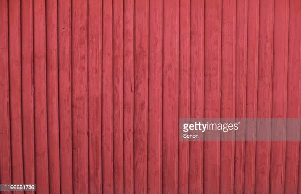 a red painted house wall in wood - barn stock pictures, royalty-free photos & images