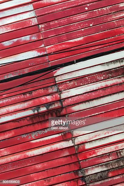 Red painted metal roll-up door detail