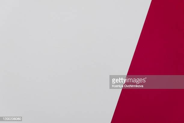 a red paper background with mottled texture. - wine stain stockfoto's en -beelden
