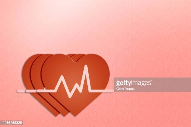 red paper heart and ekg - oscilloscope stock pictures, royalty-free photos & images