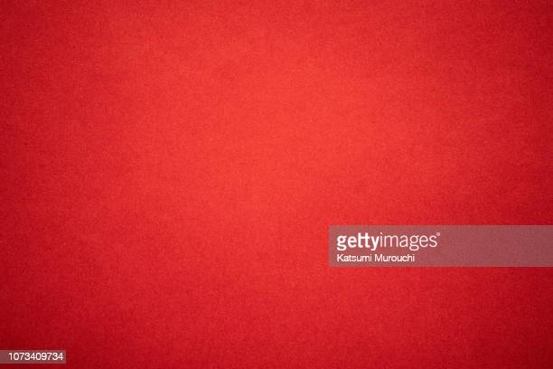 red paper texture background - rood stockfoto's en -beelden