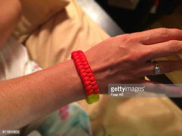 Red Paracord bracelet in hand