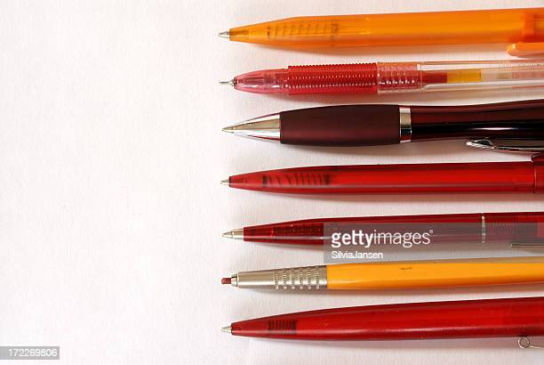 red pens - ballpoint pen stock photos and pictures