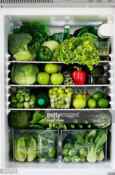red peper in fridge full of green food