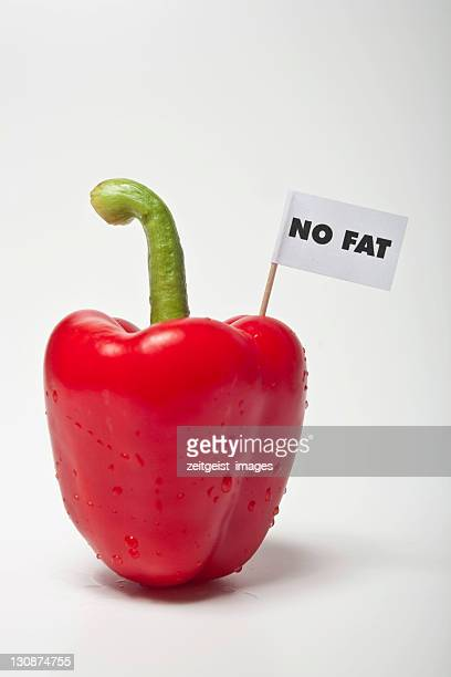 red pepper, flag saying no fat - captions stock photos and pictures