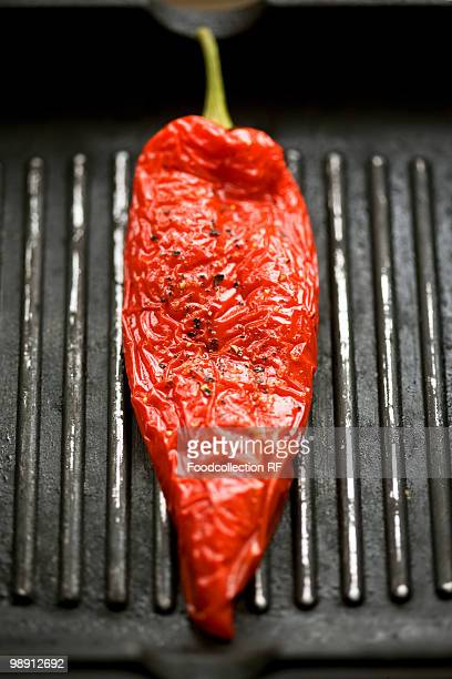 red pepper in grill frying pan, close-up - roasted pepper stock photos and pictures