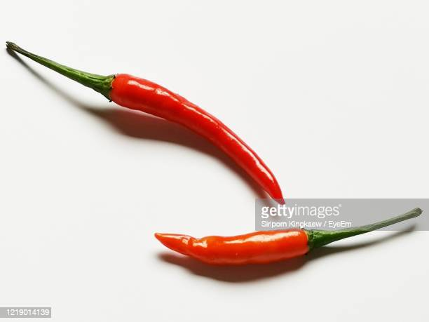 red peppers on a white background - red bell pepper stock pictures, royalty-free photos & images