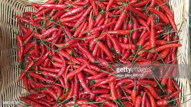 red peppers - jean marc payet stockfoto's en -beelden
