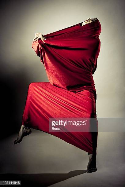 red performance - cape garment stock photos and pictures