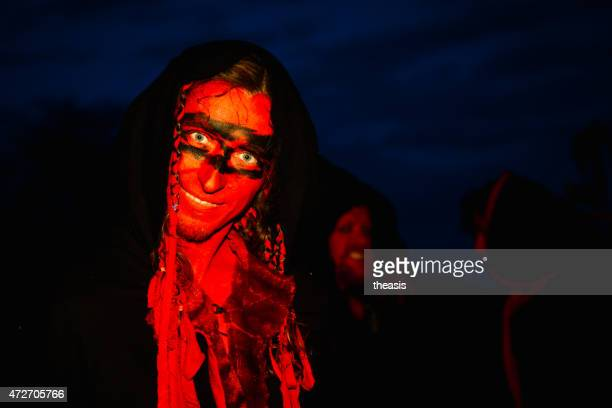 red performers at the beltane fire festival, edinburgh - beltane fire festival stock pictures, royalty-free photos & images