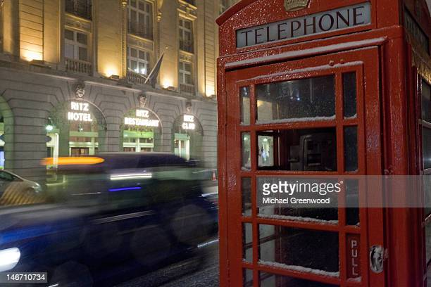 Red phone booth and black taxi