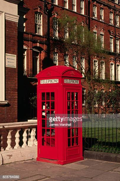 red phone booth in london - red telephone box stock pictures, royalty-free photos & images