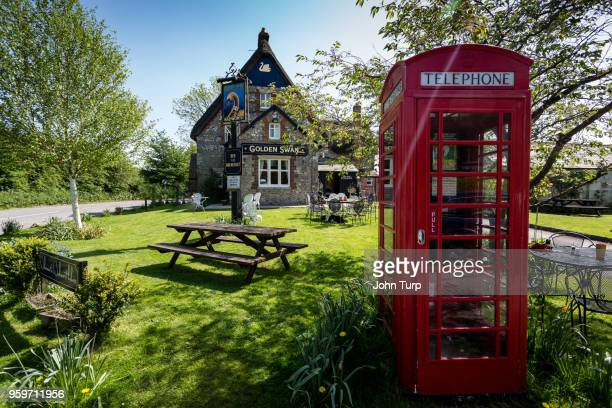 red phone box and pub at wilcot, wiltshire - english stock photos and pictures