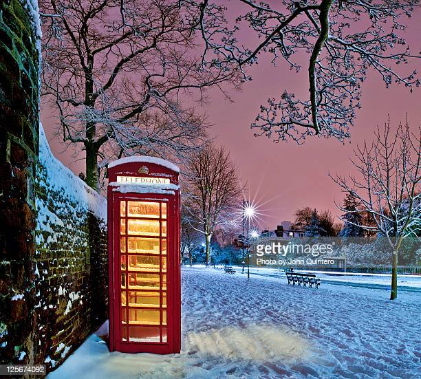 red phone box covered in snow - red telephone box stock pictures, royalty-free photos & images