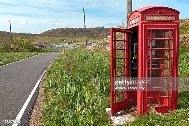red phone box in a scottish rural landscape - red telephone box stock pictures, royalty-free photos & images