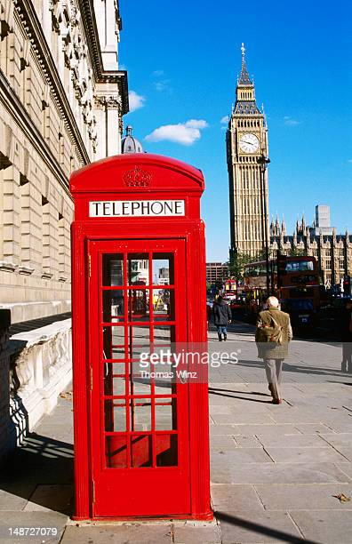 Red phone box with Big Ben in background.