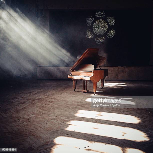red piano inside church - grand piano stock photos and pictures