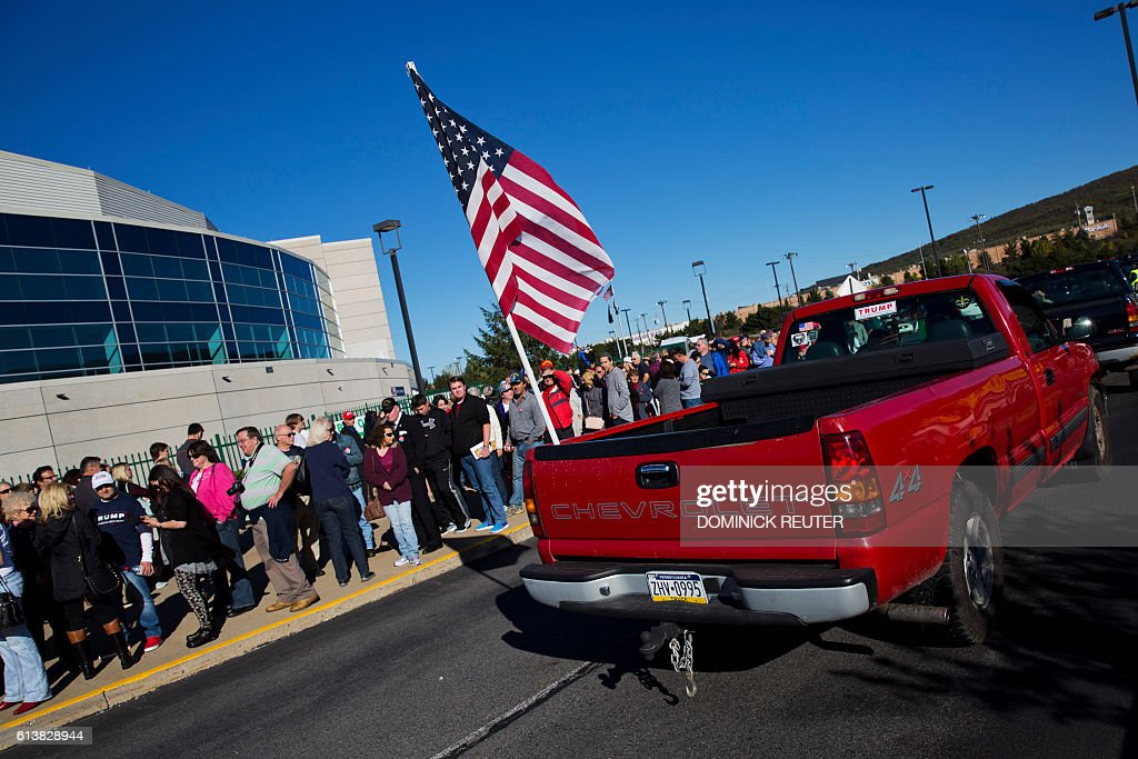 A Red Pickup Truck Trailing An American Flag Passes Supporters Of News Photo Getty Images