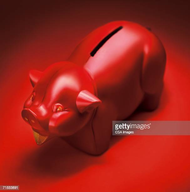 red piggy bank - coin operated stock photos and pictures