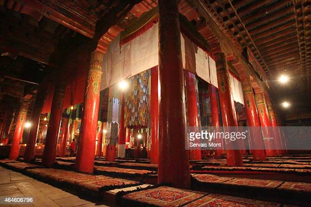 Red pillars stand in a prayer room of Kunghua monastery on March 22 2008 in Tibetan region China Kunghua monastery has been surrounded by Chinese...