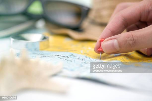 red pin on a world map. travel planning - carte france photos et images de collection