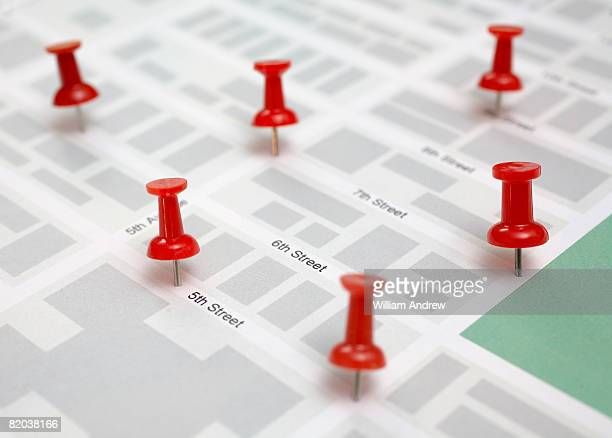 Red pins on city map