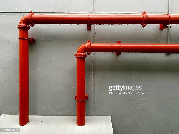 red pipelines on wall - red tube stock photos and pictures