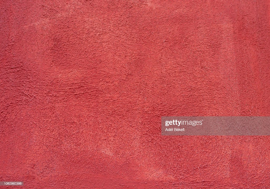 red  Plastered rusty concrete wall : Stock Photo