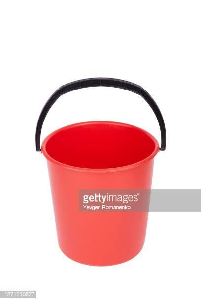 red plastic bucket, isolated on white background - バケツ ストックフォトと画像