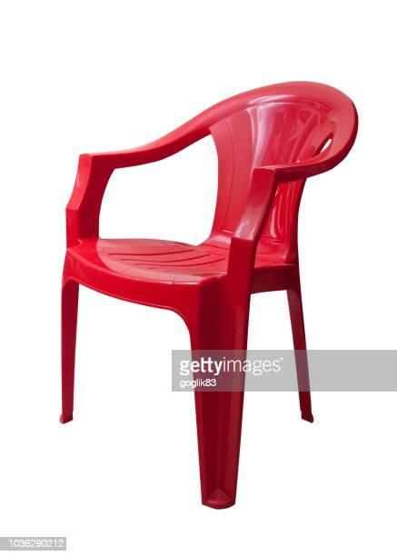 red plastic chair against white background - cadeira imagens e fotografias de stock