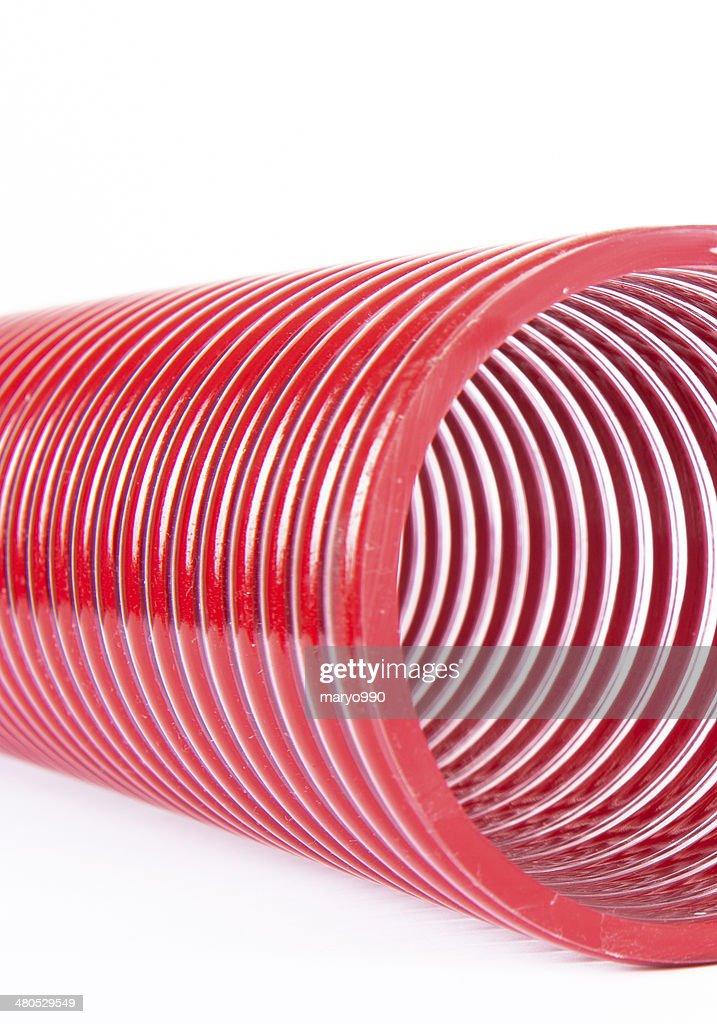 Gestell aus rotem Kunststoff verschlungenes : Stock-Foto