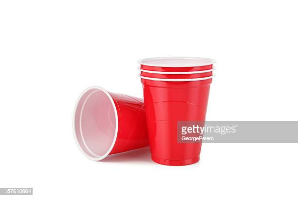 red plastic disposable cups with clipping path - disposable cup stock pictures, royalty-free photos & images