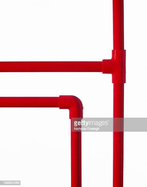 red plastic tubing - vertical red tube fotografías e imágenes de stock