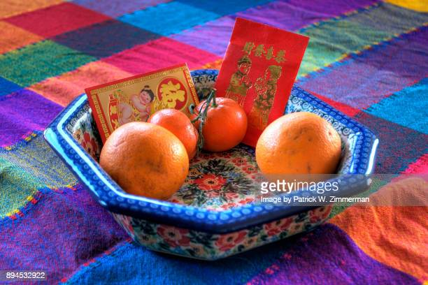 Red pockets & mandarin oranges