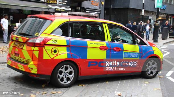 Red Police car, part of the Met's Parliamentary and Diplomatic Protection Group a unit that predominantly provides security for London's diplomatic...