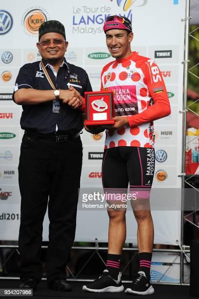 Red Polka Dot jersey winner Bernardo Albeiro Suaza Arango of Manzana Postobon Team Columbia celebrates on the podium during Stage 2 of the Le Tour de...