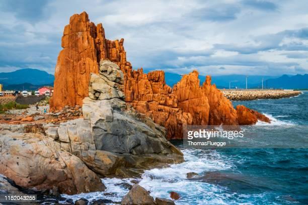 アルバタックスの赤い porphyrgestein 岩-サルデーニャ - エウロパ ストックフォトと画像