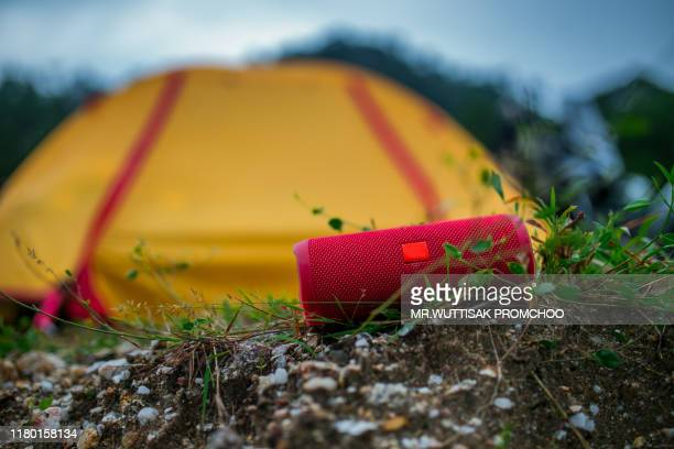 red portable speaker. - bluetooth stock pictures, royalty-free photos & images