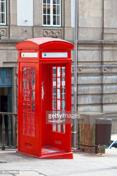 red portuguese phone booth - gwengoat stock pictures, royalty-free photos & images
